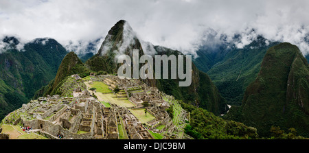 Panoramic view of the ancient Inca city of Machu Picchu in the Cuzco Region of Peru. - Stock Photo