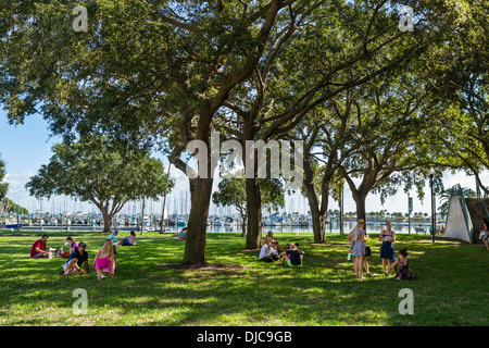 People picnicking on the grass at Progress Energy Park in downtown St Petersburg, Florida, USA - Stock Photo