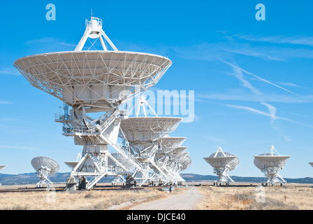 The massive radio telescopes at the Very Large Array  stand in stark contrast to the blue New Mexico sky. - Stock Photo