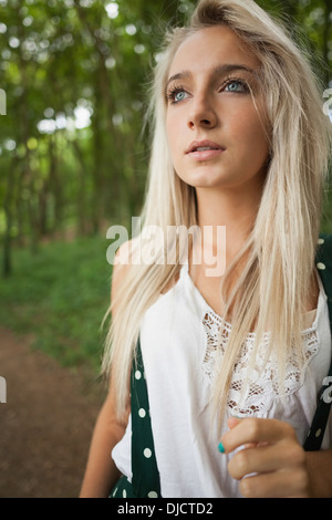 Posing gorgeous blonde standing on forest track - Stock Photo