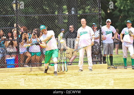 Nick Jonas playing for his Broadway Show League softball team, 'World Wide Wickets' in Central Park. Jonas was cheered - Stock Photo