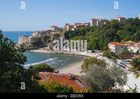 Stari Grad (Old Town) and Mala Plaza (Small Beach) in Ulcinj, Montenegro, historically a base for pirates in the - Stock Photo