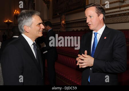 Prime Minister David Cameron talks with Austrian Chancellor Werner Faymann Queen Elizabeth II hosts a reception for visiting Heads of State to celebrate the London 2012 Olympic Games, held at Buckingham Palace London, England - 27.07.12 Stock Photo