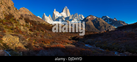 Panoramic view of Fitz Roy Massif with autum trees in the foreground.Patagonia.Argentina - Stock Photo
