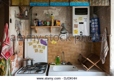 A small messy kitchen in an old French farmhouse - Stock Photo