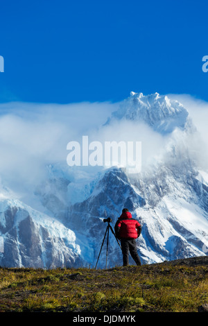 Tourists photographing scenery in Torres del Paine National Park.Chile - Stock Photo