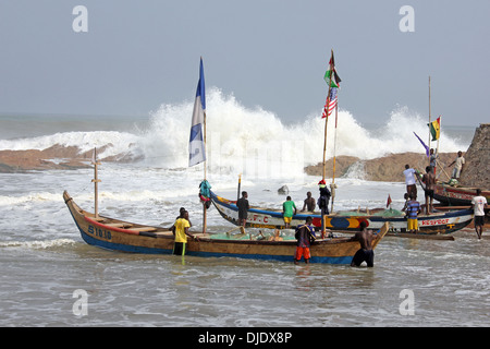 Fishermen Prepared To Launch Their Boats Into The Sea - Stock Photo