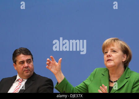 Berlin, Germany. 27th Nov, 2013. Sigmar Gabriel (L), Chairman of the Social Democratic Party (SPD) and German Chancellor Angela Merkel attend a press conference in Berlin, Germany, on Nov. 27, 2013. Leaders from Germany's main parties signed provisionally a coalition agreement on Wednesday, paving the road for forming a new government two months after a federal election. Credit:  Zhang Fan/Xinhua/Alamy Live News