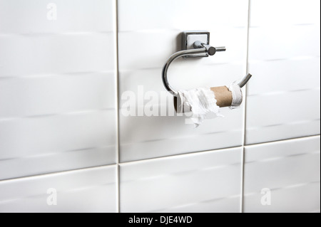 Empty toilet roll on holder.Embarrassing problem, difficult situation. - Stock Photo