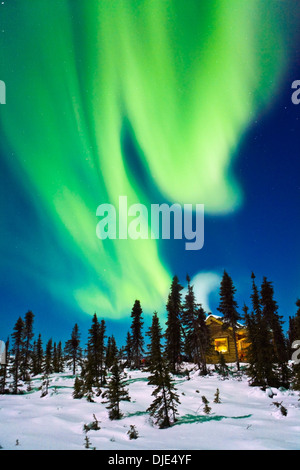 Aurora over cabin at white mountain recreation area in winter; alaska united states of america - Stock Photo