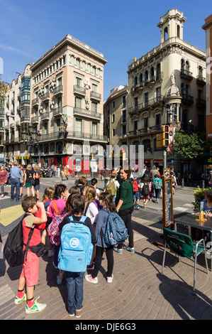 The Ramblas, school class, Modernisme buildings, Barcelona, Spain  - Stock Photo