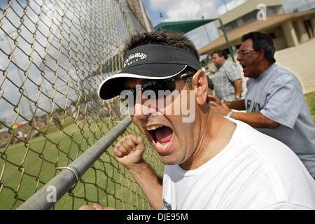 Jun 24, 2004; Lantana, FL, USA; RICK ESTRADA, of Miami, cheers on his son, pitcher Corey Estrada for the New York - Stock Photo