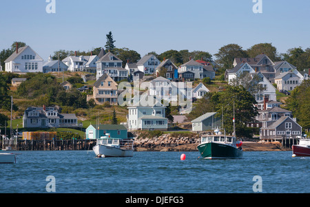 Lobster boats moored in front of the houses of the town of Stonington, ME. - Stock Photo