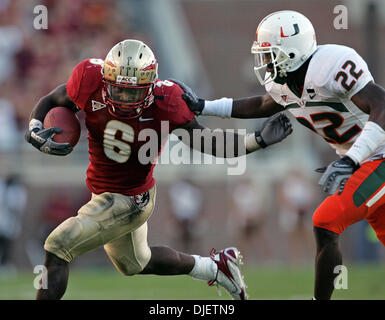 Oct 20, 2007 - Tallahassee, Florida, USA - Seminoles running back ANTONE SMITH looks for room to run as Canes #22 - Stock Photo