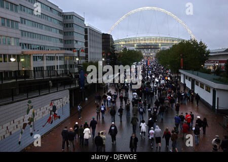 Oct 28, 2007 - London, England, UK - Football fans heading toward the stadium from the Underground stop at Wembley - Stock Photo