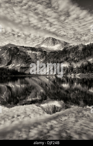 Evening light and reflection in Mirror Lake Lake with Eagle Cap Mountain. Eagle Cap Wilderness, Oregon - Stock Photo