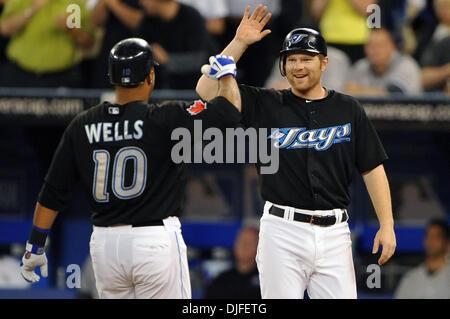 June 06, 2010 - Toronto, Ontario, Canada - 06 June 2010: Toronto Blue Jays center fielder Vernon Wells (10) is congratulated - Stock Photo