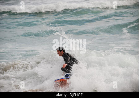 June 13, 2010 - Cape Town, SOUTH AFRICA - A body boarder rides the waves in the Camps Bay suburb of Cape Town Sunday, June 13, 2010 in South Africa. (Credit Image: © Mark Sobhani/ZUMApress.com)