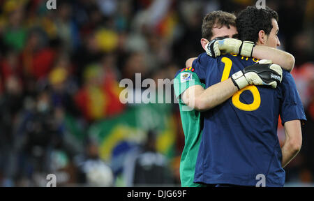 e2367406cce Iker Casillas of Spain celebrates with Sergio Busquets of Spain ...