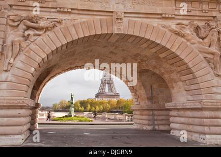 Looking through the Viaduct de Passy on Pont Bir Hakeim to the Eiffel Tower. - Stock Photo
