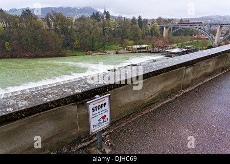 Suicide prevention sign at the Aare River, Bern Switzerland - Stock Photo