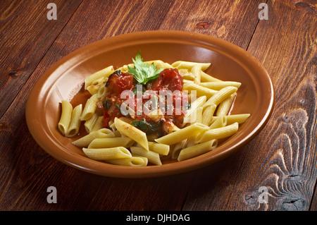 plate of penne rigata pasta with marinara sauce .farm-style - Stock Photo
