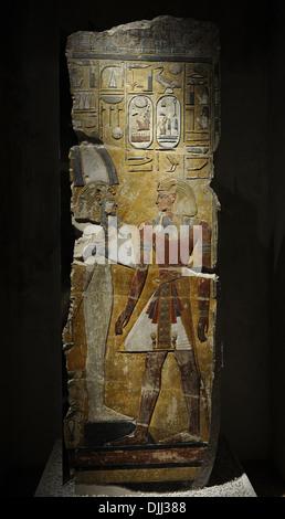 King Seti I in front of the God Osiris. Fragment of a pillar. Limestone. New Kingdom. 19th Dynasty. 1290 BC. Grave - Stock Photo