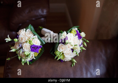 A set of bridal bouquets arranged on a leather sofa - Stock Photo