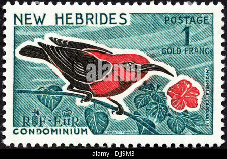 postage stamp New Hebrides Condominium 1F featuring Myzomela Cardinalis issued 1966 - Stock Photo