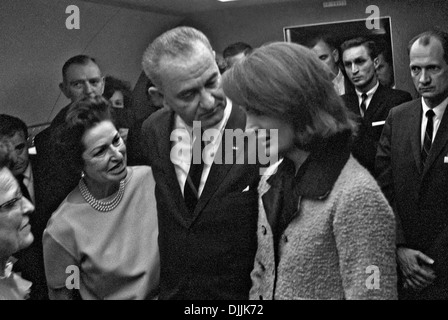 US President Lyndon B. Johnson speaks with Jacqueline Kennedy following his being sworn in as President by Judge - Stock Photo