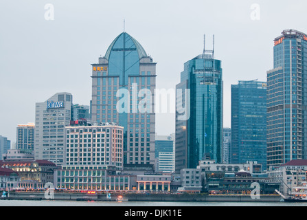 The Bund seen from Pudong in central Shanghai, China with Panorama Century Court Hotel, Seagull Hotel and others - Stock Photo