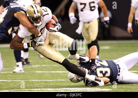 Aug 21, 2010: New Orleans Saints wide receiver Marques Colston (12) gets tackled during the preseason game between - Stock Photo