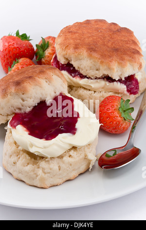 Traditional Afternoon Tea of Devonshire scones topped with clotted cream and strawberry jam often served with coffee - Stock Photo