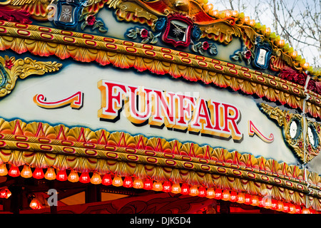Traditional Carousel funfair sign on amusement ride found at old fashioned state fairs - Stock Photo