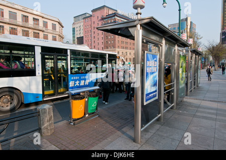 Bus stop at Middle Xizang Road in Huangpu District, Shanghai, China - Stock Photo