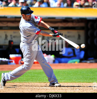 Sept. 12, 2010 - Oakland California, U.S. -Mike Lowell of the Boston Red Sox connects with a pitch against the Oakland - Stock Photo