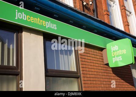 Close up Job Centre Plus green sign on building exterior wall UK - Stock Photo