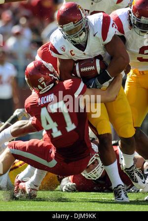 Sept. 25, 2010 - Pullman, Washington, United States of America - Sept 25, 2010:  USC full back Stanley Havili, right, - Stock Photo