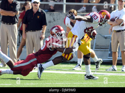 Sept. 25, 2010 - Pullman, Washington, United States of America - USC wide receiver Ronald Johnson (83) is dragged - Stock Photo