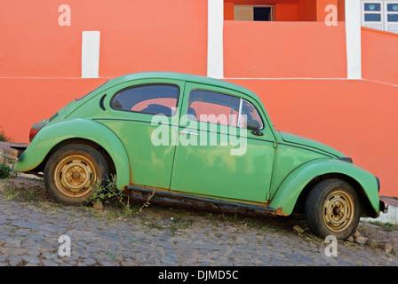 Brazil, Bahia, Lencois: Old historic Volkswagen Beetle parked in one of Lencois' cobblestone roads. - Stock Photo