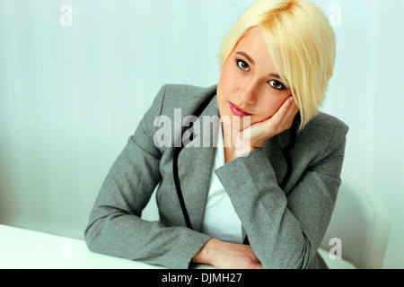 Closeup portait of a thoughtful beautiful businessswoman in office - Stock Photo
