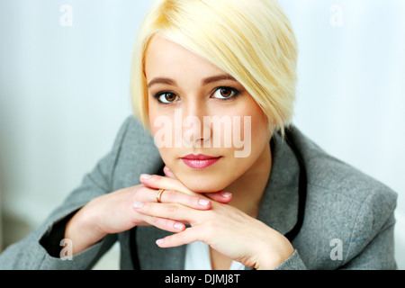 Closeup portrait of a thoughtful businesswoman in office - Stock Photo