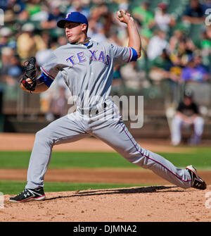 Sept. 26, 2010 - Oakland, California, United States of America - July 24, 2010: Texas Rangers starting pitcher Derek - Stock Photo