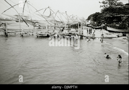 Travel Photography - Chinese fishing nets in Fort Kochi Cochin in Kerala in India in South Asia. Landscape People - Stock Photo