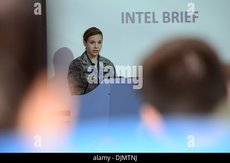 Airman 1st Class Amanda Herbert, 492nd Fighter Squadron intel analyst, gives an intel briefing to representatives - Stock Photo