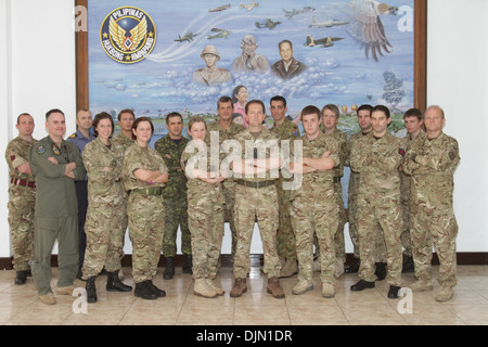 Service members from the United Kingdom, Australia, and Canada, in support of Typhoon Haiyan relief efforts, pose - Stock Photo