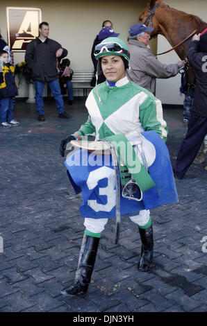 Mar 02, 2008 - South Ozone Park, Queens, NY, USA - CAROL CEDENO carrying her tack in the winner's circle after winning - Stock Photo