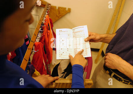 Mar 02, 2008 - South Ozone Park, Queens, NY, USA - CAROL CEDENO (L) goes over the day's card with her valet Hector - Stock Photo