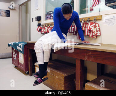Mar 02, 2008 - South Ozone Park, Queens, NY, USA - CAROL CEDENO reading over the Racing Form in the Jockey's Room. - Stock Photo