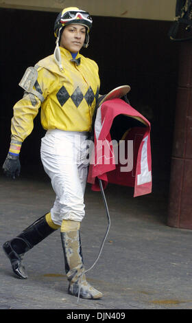 Mar 02, 2008 - South Ozone Park, Queens, NY, USA - Covered in mud CAROL CEDENO returns to the paddock following - Stock Photo